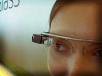 Google Glass is a computer mounted above the right eye. It contains a microphone and bluetooth capabilities. Image credit: Antonio Zugaldia as seen in Medical News Today, January 2014.